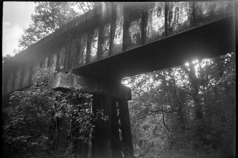 looking up, old railroad bridge, backlit, Emma Road, Asheville, NC, JB Ensign box camera, Rollei RXP 400, HC-110 developer, 10.14.19