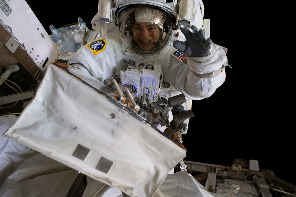NASA astronaut Jessica Meir waves at the camera during a spacewalk