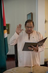 Prime Minister, Hon. Moses Nagamootoo sworn in to perform the duties of the President of the Cooperative Republic of Guyana, by Justice Rishi Persaud.