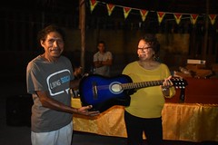 Minister within the Ministry of Indigenous People's Affairs, Hon. Valerie Garrido-Lowe donates a guitar to the village.