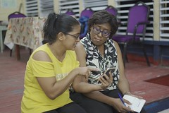 Minister of Public Telecommunications, Hon Catherine Hughes interacts with a resident.
