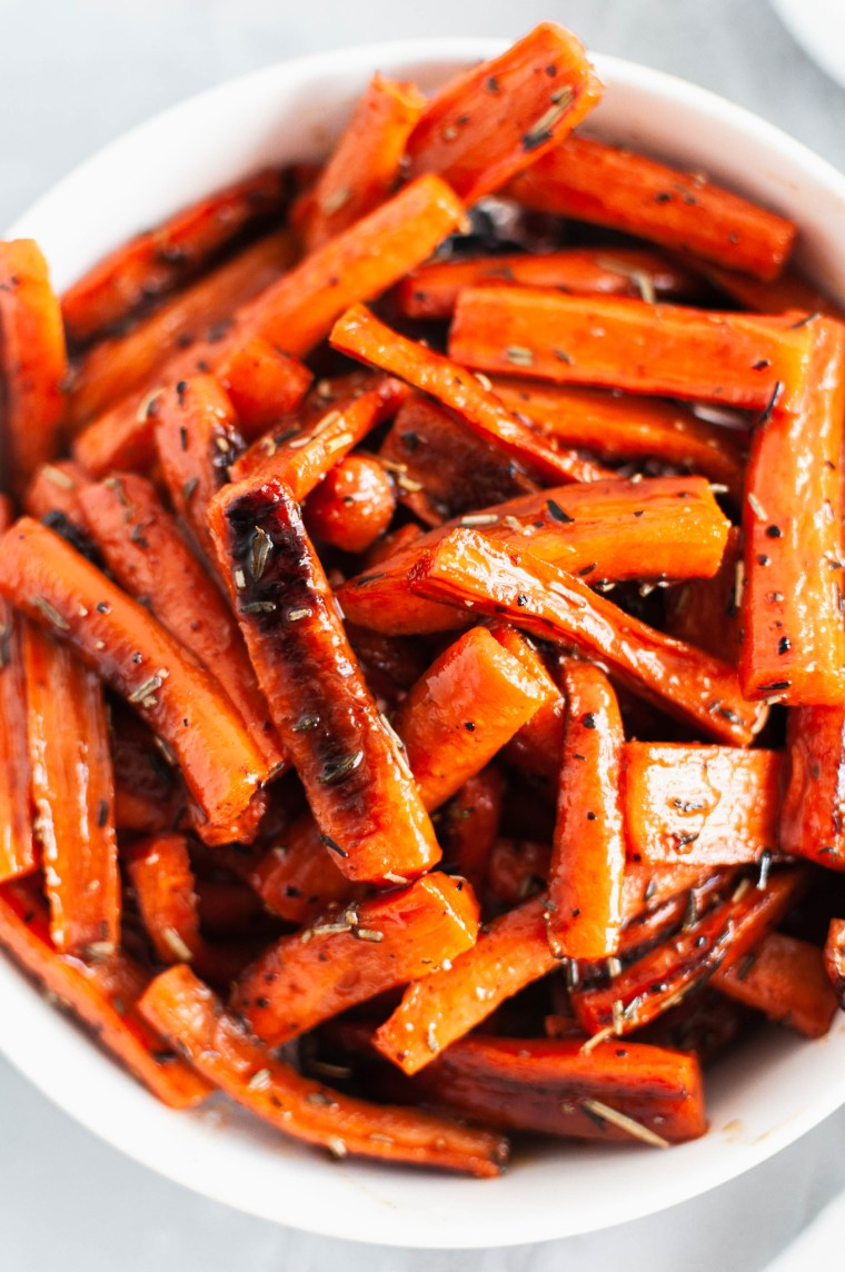 These Honey Balsamic Roasted Carrots are holiday and weeknight perfection. They are tangy and slightly sweet.
