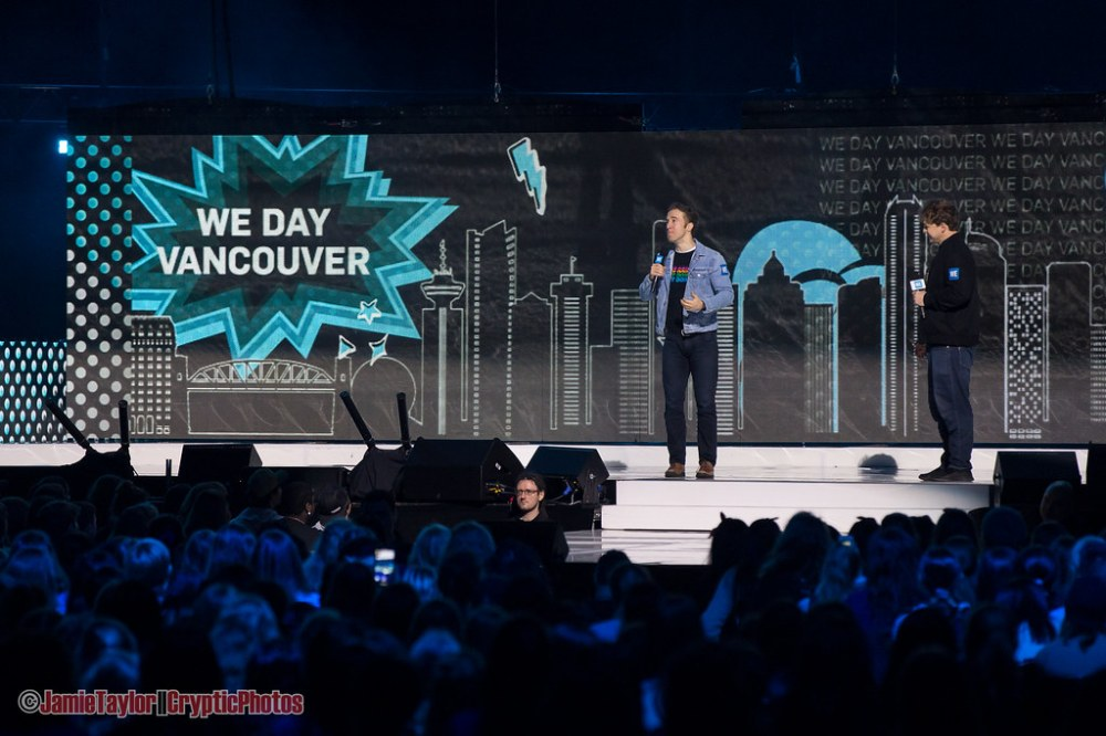 Founders Marc and Craig Kielburger speaking at WE Day youth empowerment event at Rogers Arena in Vancouver, BC on November 19th, 2019