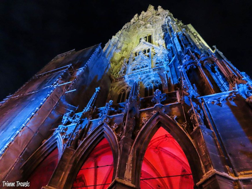 St. Stephen's Cathedral illuminated in red, blue and yellow