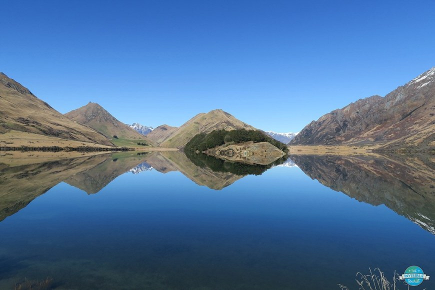THe mountain reflecting in the blue water of the lake