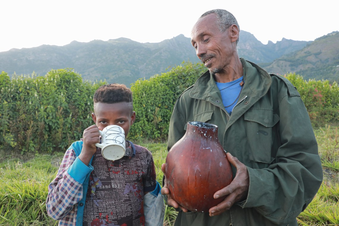A farmer shares his milk produce to his son