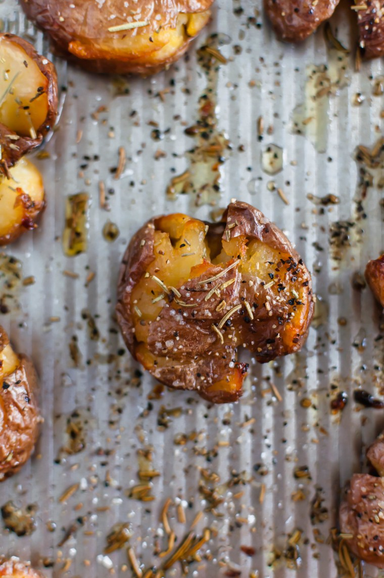 Rosemary Smashed Potatoes are just what you need this holiday season. Fancy enough for guests but easy enough for weeknights. Super crispy and flavorful.