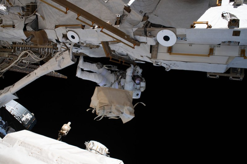 NASA astronaut Andrew Morgan is tethered to the International Space Station
