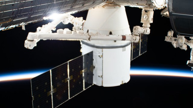 The SpaceX Dragon resupply ship is installed to the Harmony module