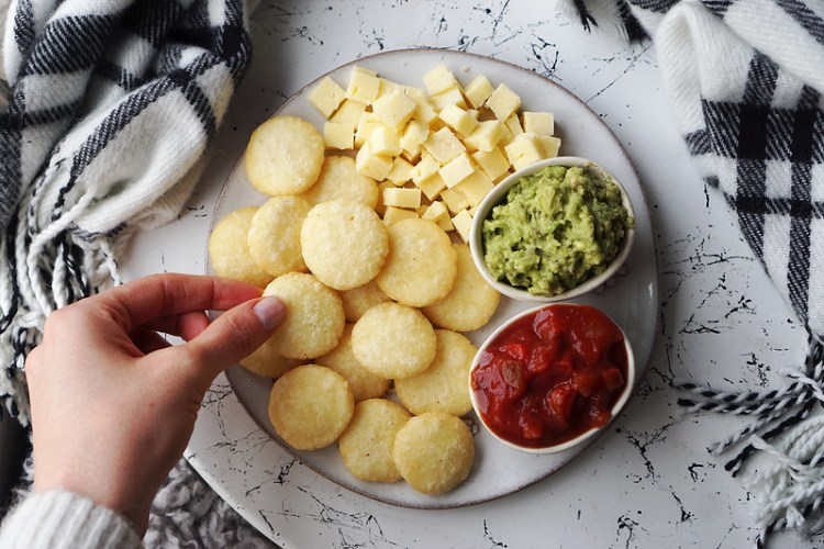 Fried and crispy mini arepas with cheddar cheese cubes and guacamole and salsa to dip in | naturally gluten free South American flat breads made of cornmeal