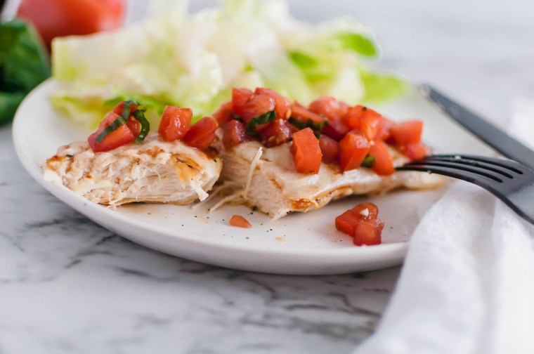This Bruschetta Chicken comes together in less than 30 minutes for the perfect simple, healthy and fresh dinner. Perfectly seared chicken, lots of melted mozzarella and a super simple homemade bruschetta.