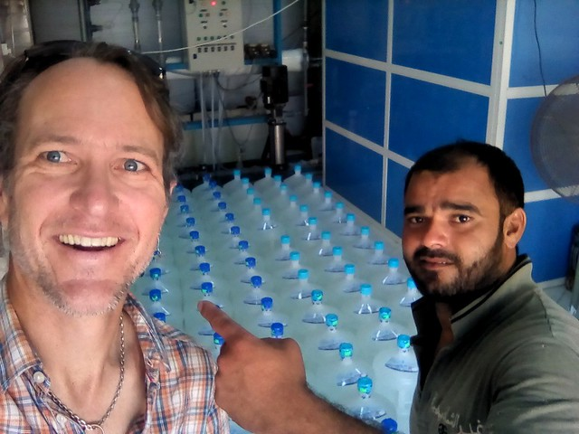 Muhamed Osman from Lahore who works at this small water filtration operation by bryandkeith on flickr