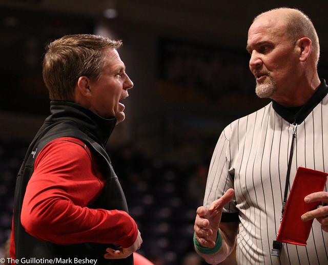 MSU Moorhead coach Kris Nelson and referee Jerry Reker - 200206mb0123