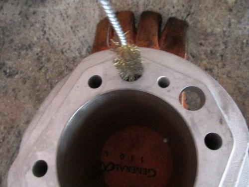 Use Wire Brush To Burnish Inside of Push Rod Tube Holes