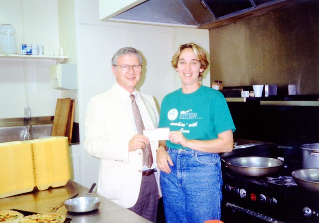 Laurie Leonard of Mama's Kitchen accepting donation, 1991