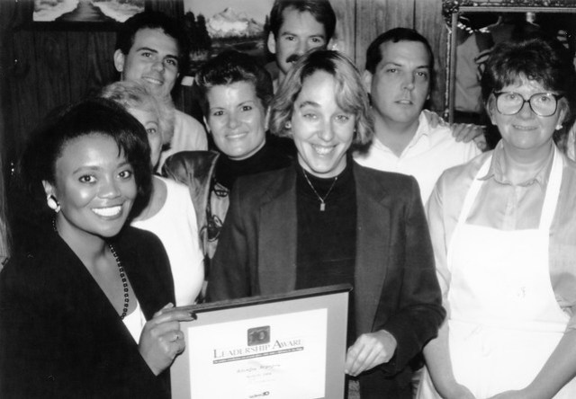 Laurie Leonard of Mam's Kitchen receiving award from Channel 10 San Diego, 1991. Ruth Hendricks of Special Delivery on far right