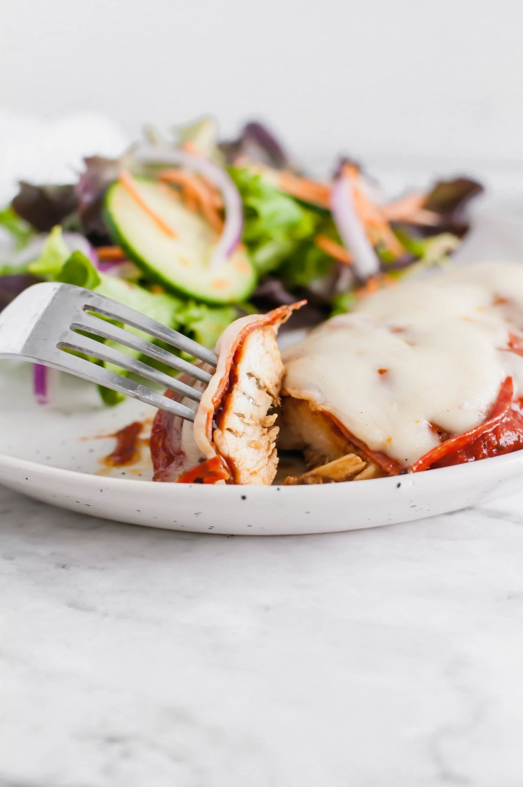 This Pizza Chicken is sure to be a new family favorite. Marinated chicken, grilled to perfection and topped with the best pizza toppings.