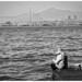 Pêcheurs sur les bords de la baie de Victoria à Hong Kong