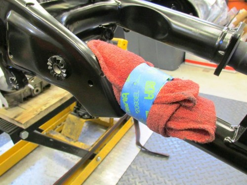 Shop Rag with Tape Protects New Powder Coat From Scratching On Muffler Bracket