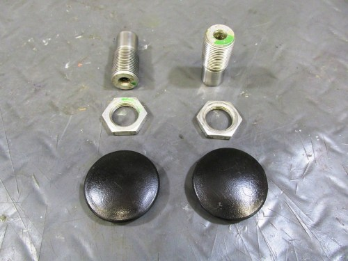 Swing Arm Mounting Hardware Detail: (Top)-Pivot Bolts; (Middle) Lock Nuts; (Bottom) Plastic Dust Caps