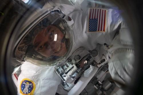 Flight Engineer Bob Behnken is pictured in his U S  spacesuit