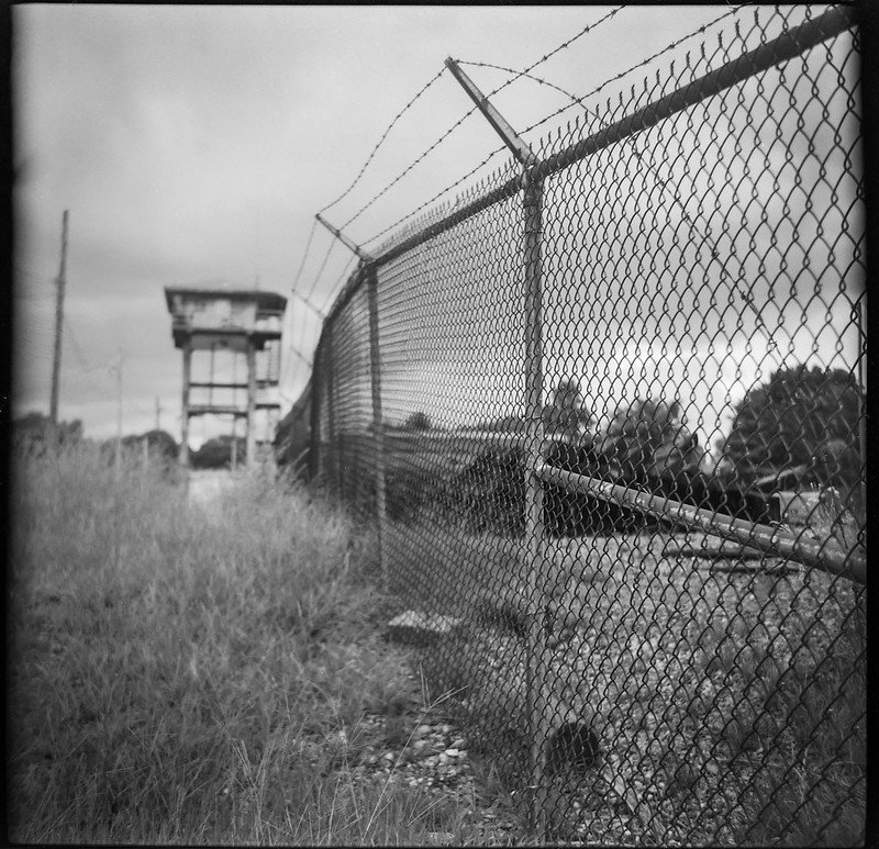 chain link fence, barbed wire, lookout tower, Norfolk Southern Railway, river district, Asheville, NC, Zeiss Ikonta M, Fomapan 200, Moersch Eco film developer, 7.15.20