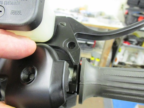 Throttle Cam Cover Tab Fits In Groove Of Throttle Tube To Secure It