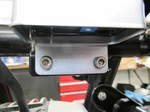 Allen Bolts Secure Voltage Regulator To Bracket On Right Side Of Frame Tube