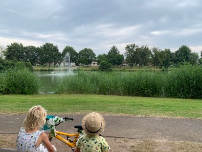Enjoying a bike trip around the pond..