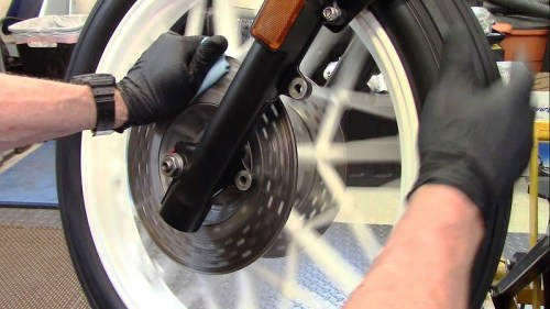 Rotate Wheel With Towel Sprayed With Brake Cleaner Wrapped Around The Disk