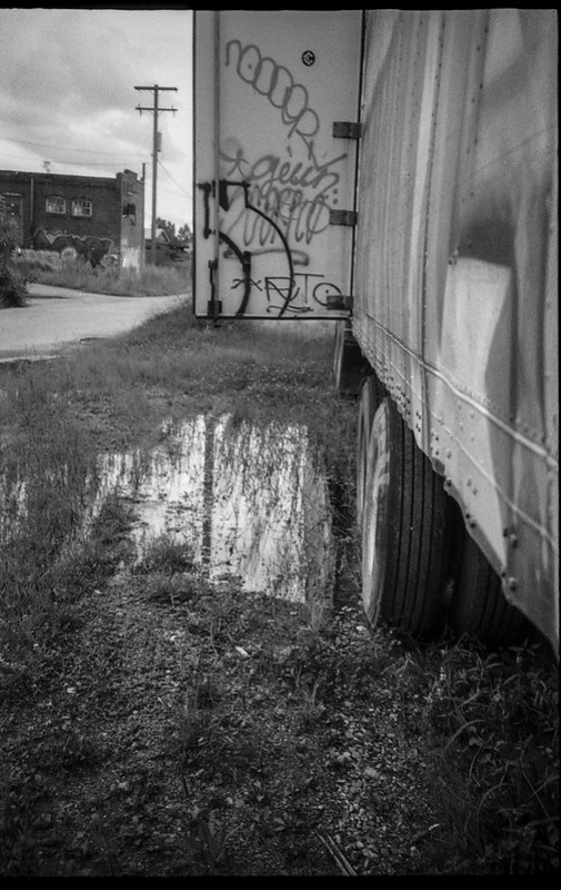 abandoned tractor trailor, standing water, reflection, Asheville Waste Paper Company, Asheville, NC, Leica C1, Fomapan 200, Moersch Eco film developer, late August 2020