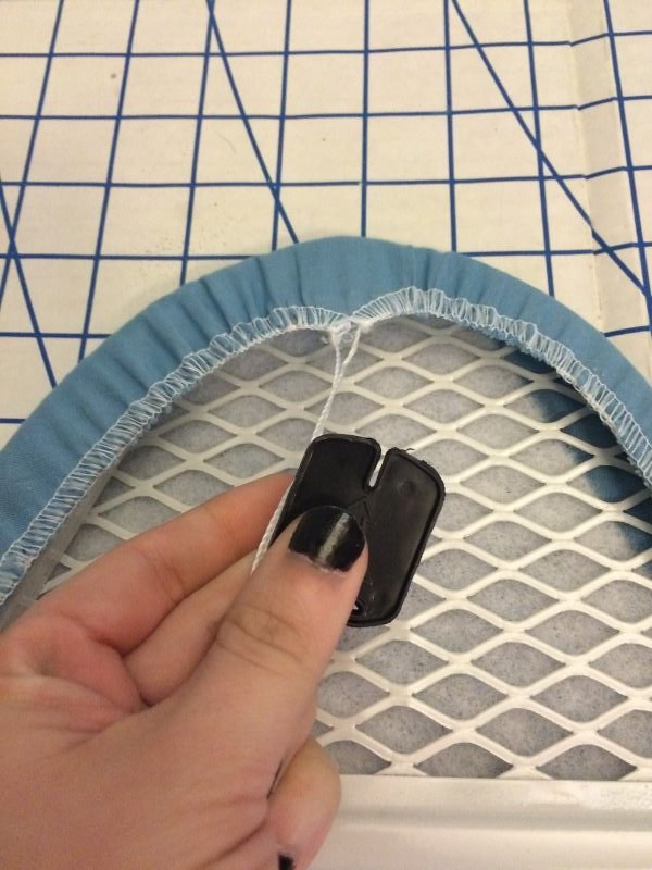 Plastic piece to tighten the drawstring. Set this aside for later.