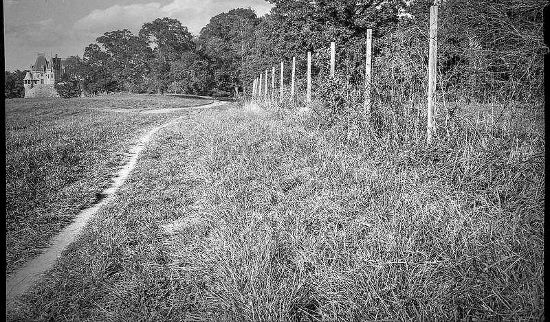 foot trail, fence, distant mansion, Biltmore Estate, Asheville, NC, Kodak Bantam, folding 828 film camera, Kodak TMAX 400, HC-110 developer, 10.6.20