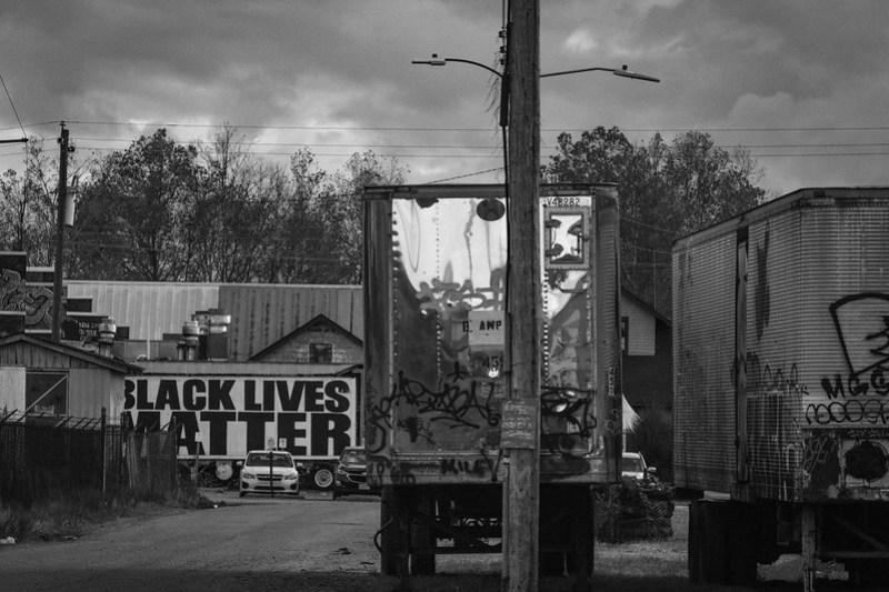 urban landscape, abandoned trailers, Black Lives Matter, dusk, Railroad District, Asheville, NC, Nikon D3300, mamiya sekkor 145mm f-4, 11.8.20