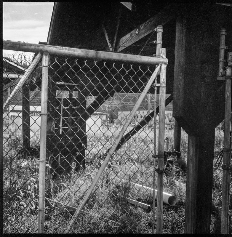 understructure, storgae building, metal fence, Norfolk and Southern Railway, Asheville, NC, Ricohflex Dia M, Foma 200, Moersch Eco developer, 11.17.20 (1 of 1)