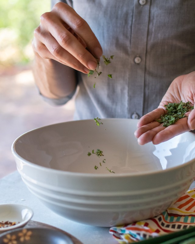 adding minced sage to the pie dough for extra flavor