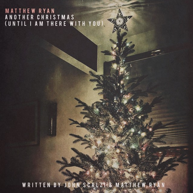 "The cover to ""Another Christmas (Until I Am There With You)"", which features a Christmas tree, with a moody art filter."