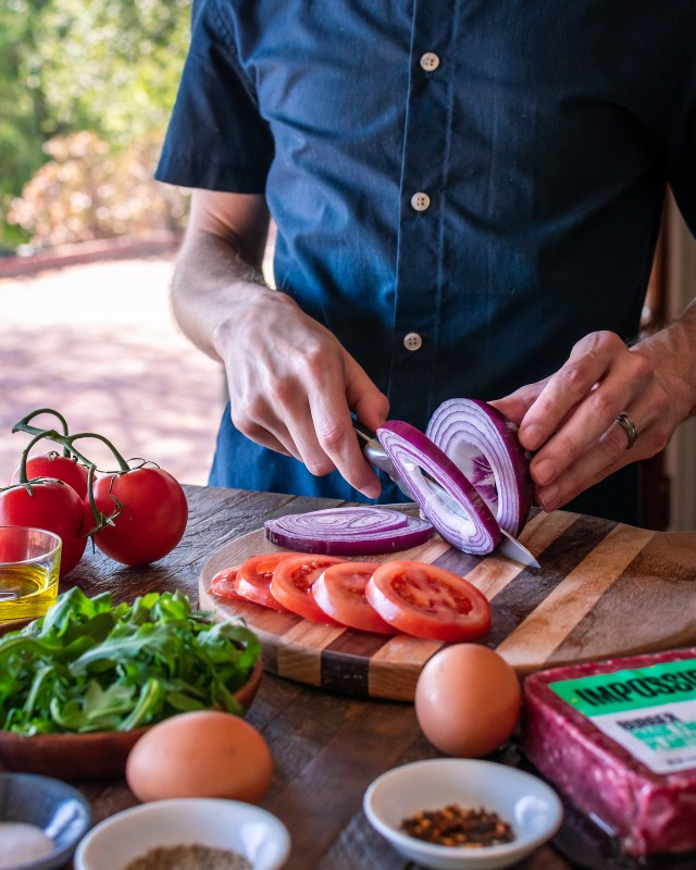 slicing red onions and tomatoes for garnish