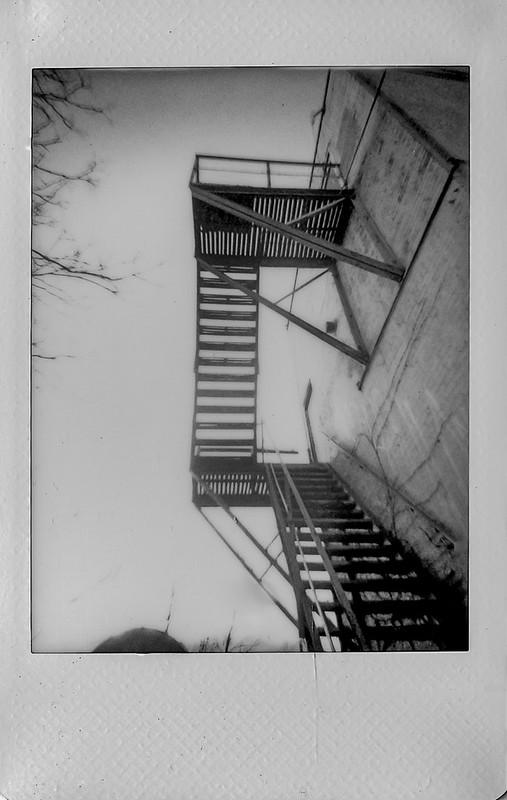 looking up, fire escape River Arts District, Asheville, NC, Lomo'Instant, Instax Mini Monochrome, 1.4.21