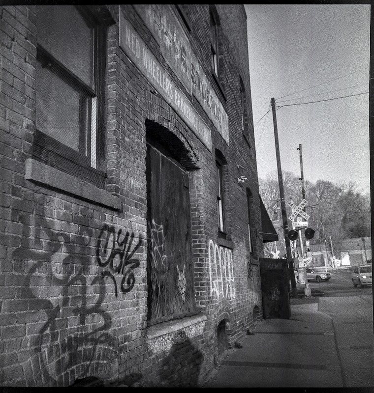 brick facade, urban decay, Lyman Street, Asheville, NC, Eho Altissa box camera, Bergger Pancro 400, Ilford Ilfosol 3 developer, 2.1.21