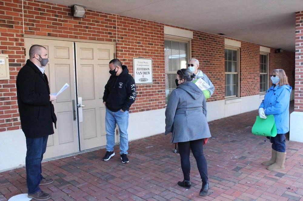 Jody, Angel and Marita delivering petition signatures to Congressman Van Drew's Staff's staff