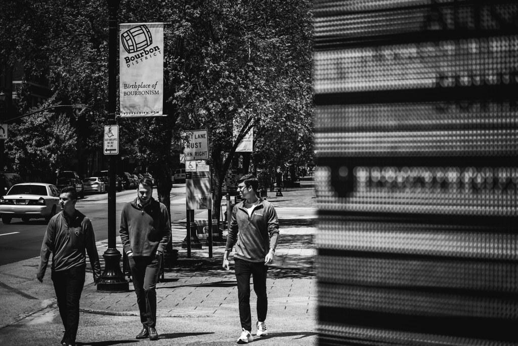 Three Friends Behind A Digital Sign