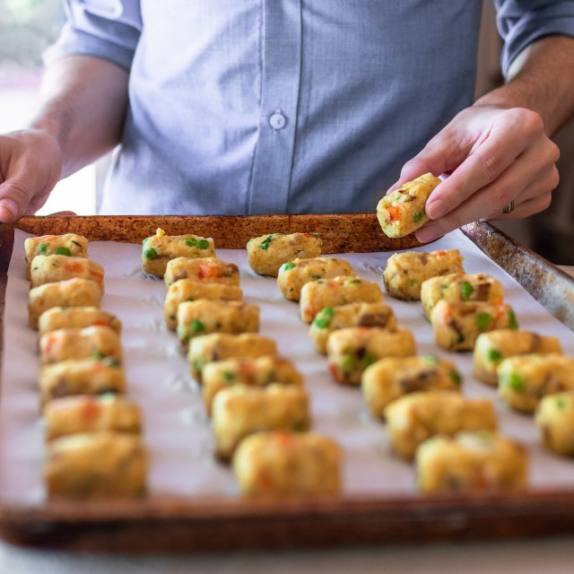 placing the final tot on the baking sheet