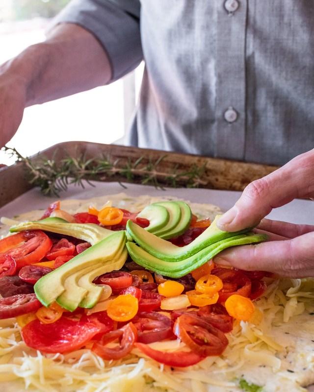 placing the fresh avocado slices