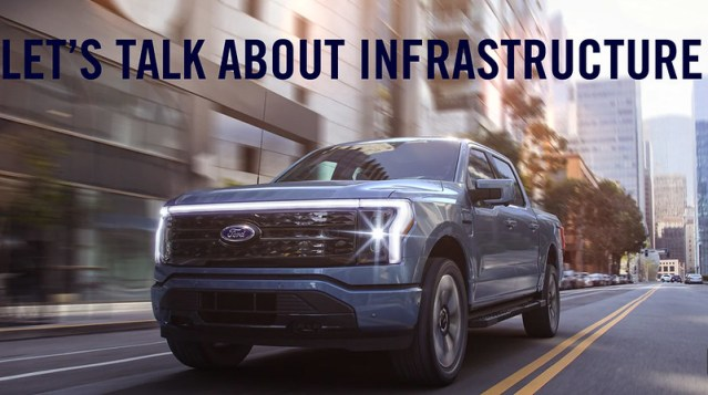 """A picture of the upcoming Ford F-150 Lightning, with the words """"Let's Talk About Infrastructure"""" above the truck."""