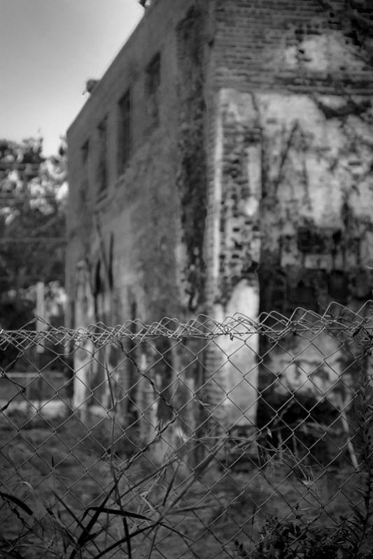 abandoned mill, through a wire fence, brick, railroad district,  Asheville, NC, Goerz Pocket Roll Film Tenax camera, Fomapan 200, HC-110 developer, 8.12.21