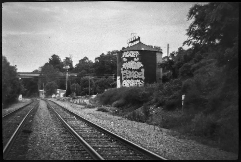 abandoned storage silo, graffiti, trackside, urban decay, railroad district, Asheville, NC, Bencini Koroll 24S, Fomapan 400, HC-110 developer, 8.30.21