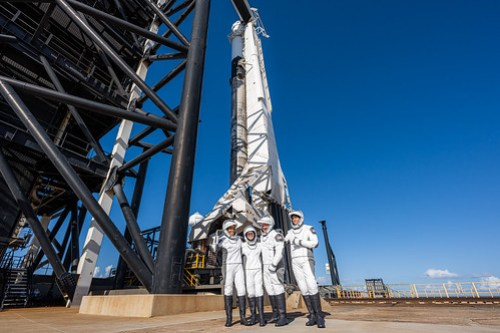 Posing with Falcon 9 and Dragon