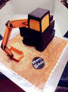 back hoe theme cake