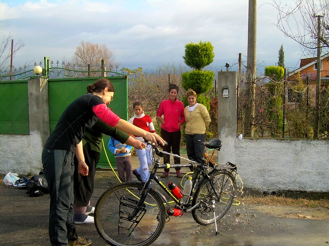 Great help to clean mud from Snežana's bicycle by bryandkeith on flickr